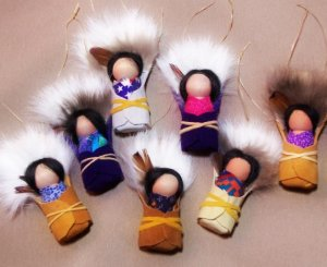 PAPOOSE ORNAMENTS, wood, leather, cloth, feather and fur make the adorable little keepsakes.  Limited supply  as these are very popular.